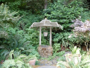 The wishing well at Berry's is nestled in a ferny dell