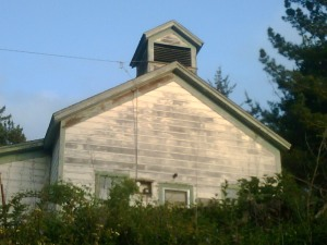 Schoolhouse near Half Moon Bay, CA, with cupola, painted cream with green trim