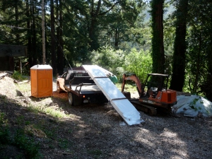 Flatbed truck with lift delivers Cumaru to the Schoolhouse