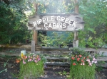 The sign for Ripple Creek Cabins