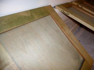 Cabinet door with bronze highlight