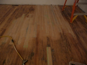 Sanded floor with fresh patch