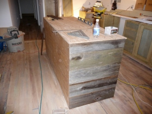 Side of kitchen island showing salvaged redwood