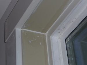 Same corner of window frame, caulked