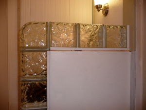 Wall edged in glass block