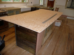 Full size sheet of plywood on island counter