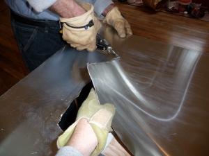 Steve cuts the zinc sheet