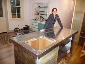 Beth standing by zinc counter