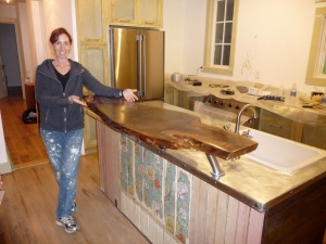 Beth stands by finished kitchen island