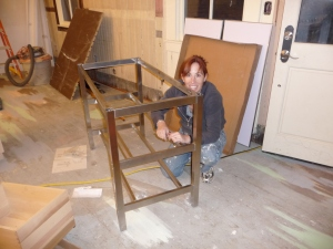 Beth putting together Ikea stainless steel shelf unit
