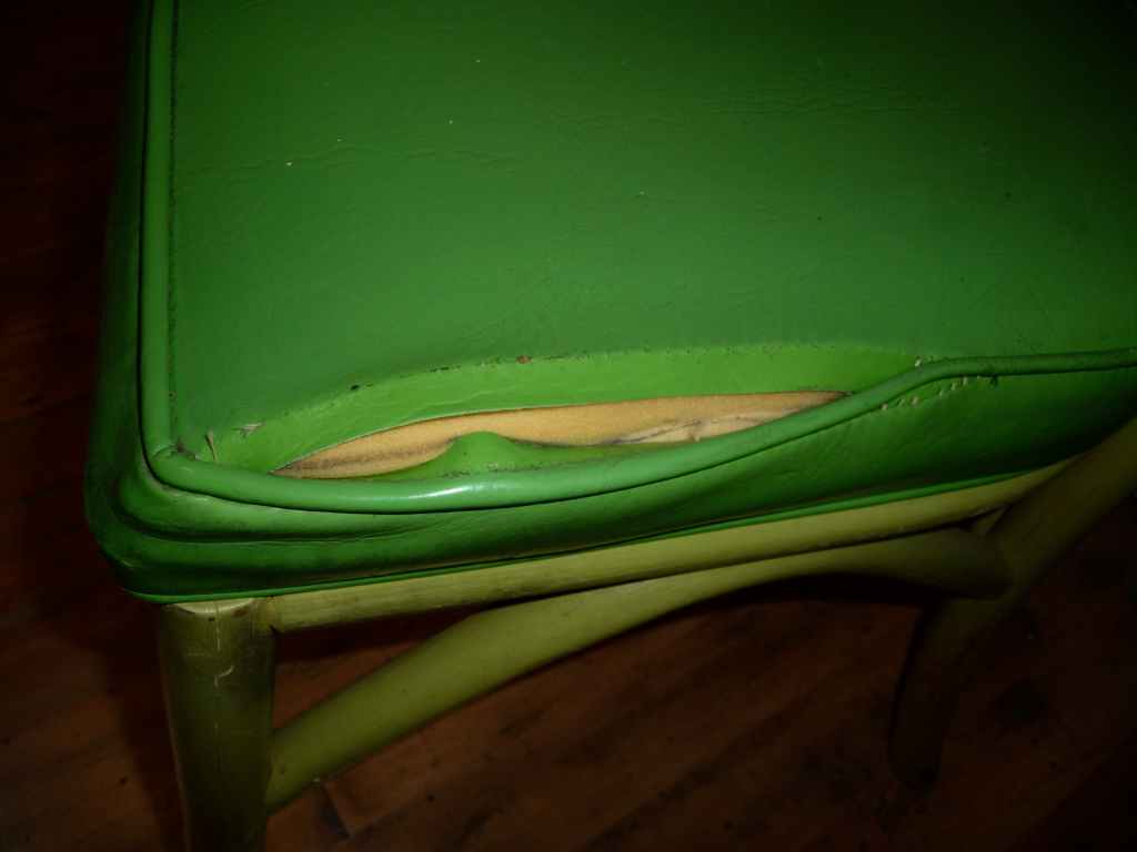 Chair with ripped seam in seat cushion