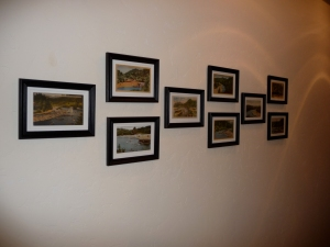 9 framed vintage postcards