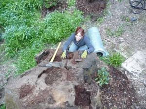 Beth crawling around on stump